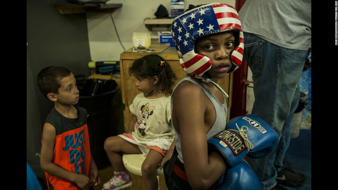 """The boxing gym felt like a safe haven in a very troubled world,"" photographer Alex Webb said. ""Kids of all ages came to the gym -- the youngest simply to hang out, the older ones to box."""