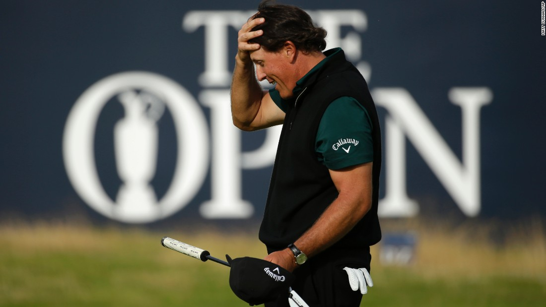 "Phil Mickelson reacts Thursday, July 14, after barely missing a putt that would have given him a first-round 62 at the British Open. No one has ever shot 62 in a major tournament. Mickelson <a href=""http://edition.cnn.com/2016/07/14/golf/the-open-championship-day-one-mickelson-golf/index.html"" target=""_blank"">finished with a 63</a> and went on to finish the tournament in second place behind Henrik Stenson."