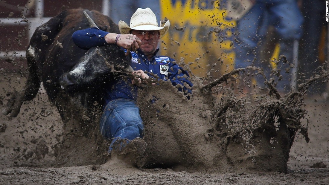 Casey Martin wrestles a steer in the mud during the Calgary Stampede on Sunday, July 17.