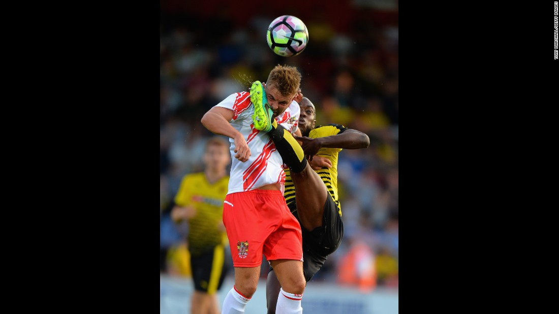 Watford's Allan Nyom, right, competes for a ball with Stevenage's Matt Godden during a preseason friendly match in Stevenage, England, on Thursday, July 14.