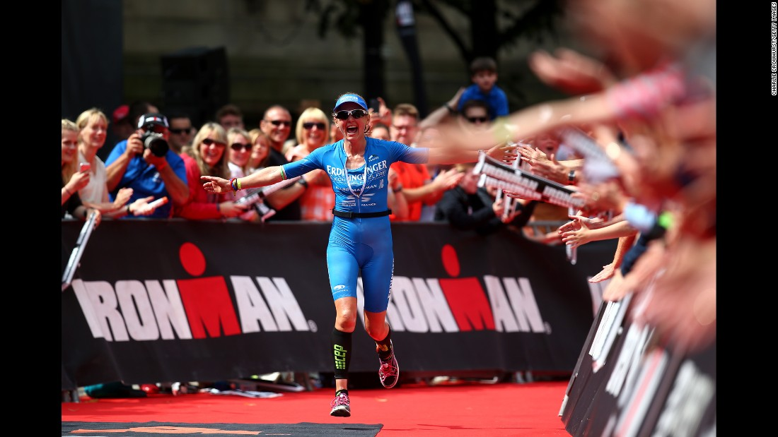 Lucy Gossage crosses the finish line to win the Ironman race in Bolton, England, on Sunday, July 17.