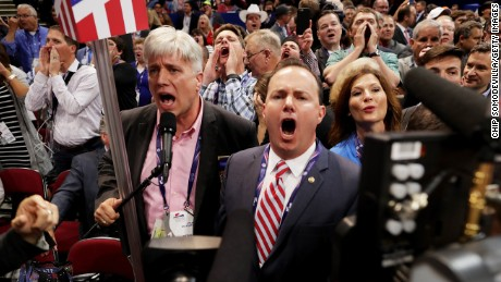 Sen. Mike Lee, (R-UT) (C) and Phill Wright, Vice Chair of the Utah State Delegation (L) shout no to the adoption of rules without a roll call vote on the first day of the Republican National Convention on July 18, 2016 at the Quicken Loans Arena in Cleveland, Ohio. An estimated 50,000 people are expected in Cleveland, including hundreds of protesters and members of the media. The four-day Republican National Convention kicks off on July 18.
