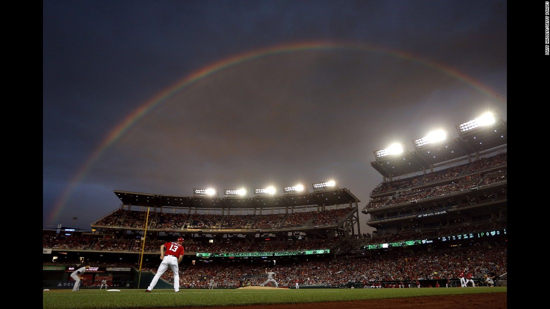 A rainbow appears over Nationals Park during a Major League Baseball game in Washington on Saturday, July 16.