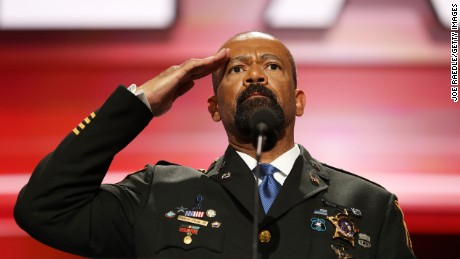 Milwaukee County Sheriff David Clarke salutes the crowd prior to delivering a speech on the first day of the Republican National Convention on July 18, 2016 at the Quicken Loans Arena in Cleveland, Ohio. An estimated 50,000 people are expected in Cleveland, including hundreds of protesters and members of the media. The four-day Republican National Convention kicks off on July 18.