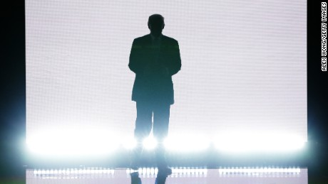 Presumptive Republican presidential nominee Donald Trump enters the stage to introduce his wife Melania on the first day of the Republican National Convention on July 18, 2016 at the Quicken Loans Arena in Cleveland, Ohio. An estimated 50,000 people are expected in Cleveland, including hundreds of protesters and members of the media. The four-day Republican National Convention kicks off on July 18.