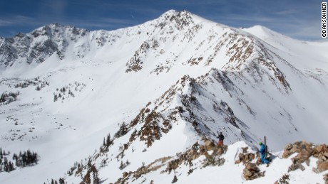 Climbing up peaks is part of the challenge of skiing the park's highest mountains.