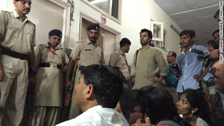 Security doesn't stop protesters from entering a hospital where a woman is treated in an alleged rape.