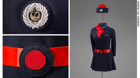 This Japan Airlines uniform incorporates two national symbols: a crane and the rising sun.