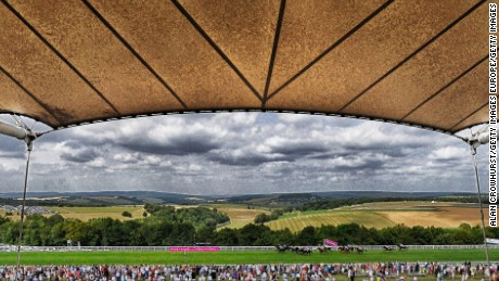 CHICHESTER, ENGLAND - JULY 31: (EDITORS NOTE: This images was processed using digital filters) A general view as runner make their way past the Sussex Stand at Goodwood racecourse on July 31, 2014 in Chichester, England. (Photo by Alan Crowhurst/Getty Images)