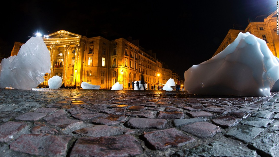 "Olafur Eliasson installed 1<a href=""http://edition.cnn.com/2015/12/08/opinions/sutter-ice-watch-cop21-two-degrees/"">2 blocks of ice</a> from Greenland in Paris'  Place du Pantheon during the December 2015 COP21 climate change conference. The blocks melted away over 12 days, highlighting the effects of climate change."
