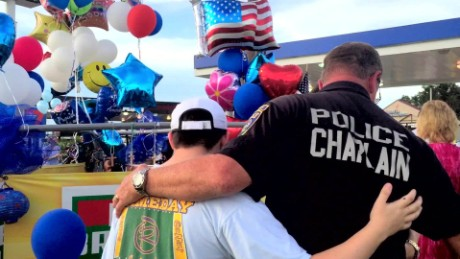 Police chaplain comforts after deaths