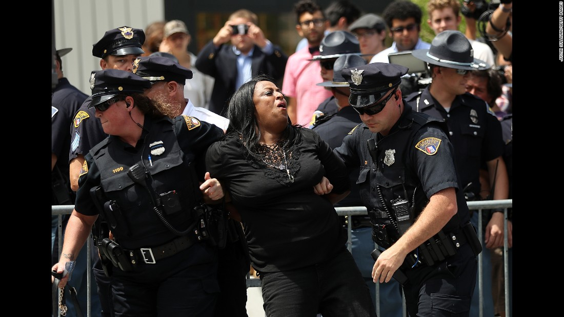 Police officers detain a protester in Public Square on Monday.