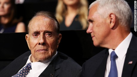 Indiana Gov. Mike Pence (R) speaks with World War II veteran and former Sen. Bob Dole (R-KS) on the first day of the Republican National Convention on July 18, 2016 at the Quicken Loans Arena in Cleveland, Ohio.