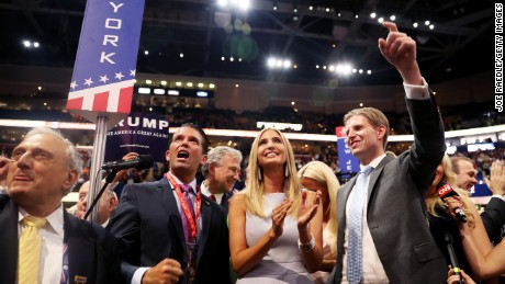 Donald Trump Jr. (2nd-L) along with Ivanka Trump (C) and Eric Trump (R), announce take part in the roll call in support of Republican presidential candidate Donald Trump on the second day of the Republican National Convention on July 19, 2016 at the Quicken Loans Arena in Cleveland, Ohio. An estimated 50,000 people are expected in Cleveland, including hundreds of protesters and members of the media. The four-day Republican National Convention kicked off on July 18.