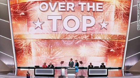 "A screen reads ""Over The Top"" after Republican presidential candidate Donald Trump received the number of votes needed to secure the party's nomination, on the second day of the Republican National Convention on July 19, 2016 at the Quicken Loans Arena in Cleveland, Ohio."