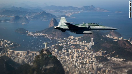 An F-5 fighter flies over Rio during a Brazilian Air Force security demonstration before the Games.