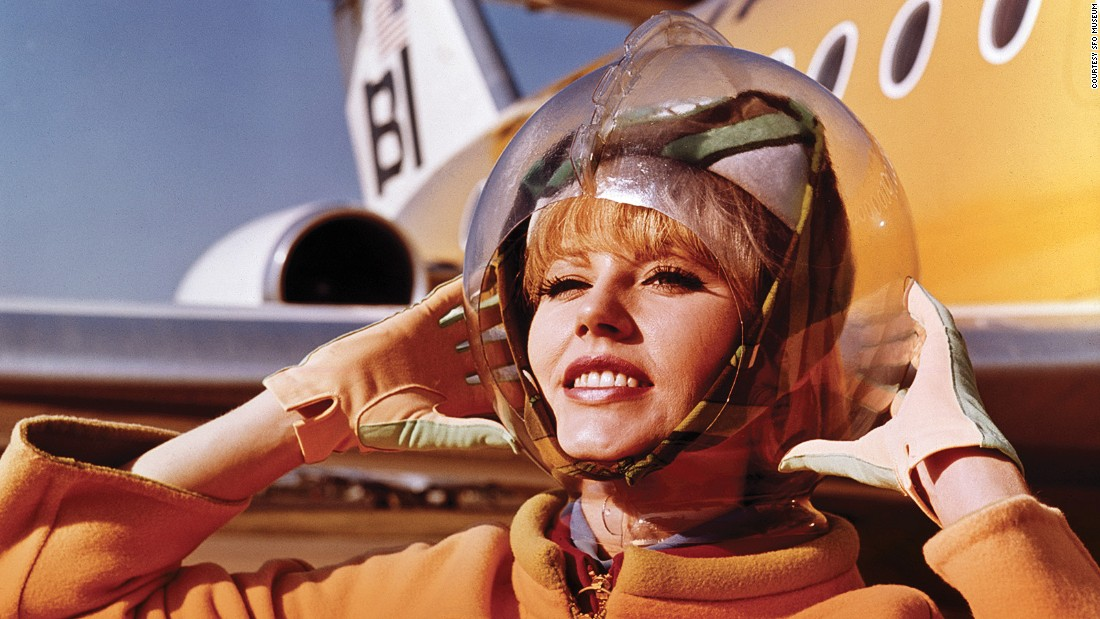 In a 1965 look designed by Emilio Pucci, a Braniff International Airways hostess displays her space bubble helmet. No, these were not very practical.