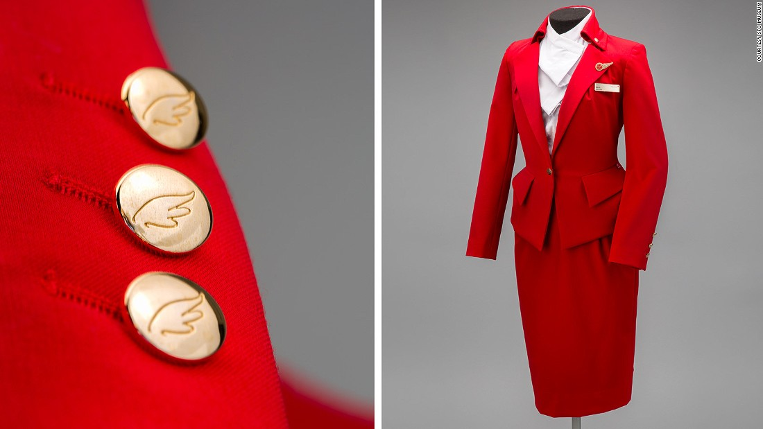 Dame Vivienne Westwood brought her aesthetic to Virgin Atlantic in 2014 with this scarlet tailored suit with bold gold buttons, complete with wing insignia.