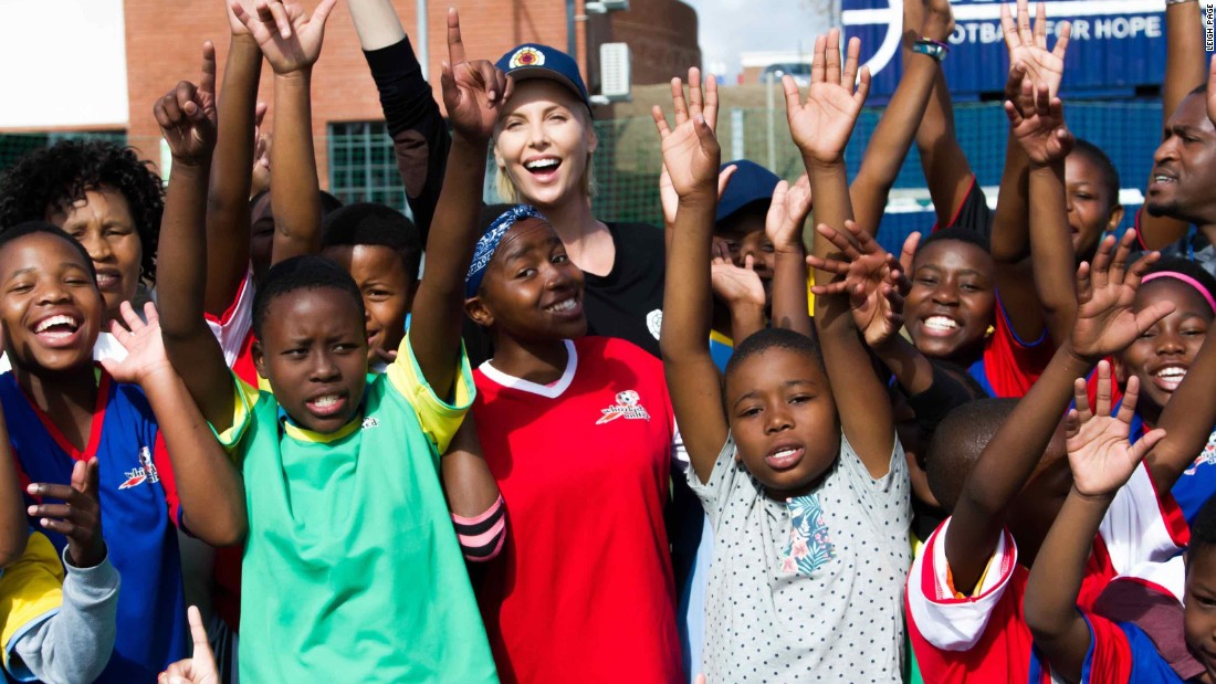 "Theron with children from<a href=""http://www.whizzkidsunited.org/"" target=""_blank""> WhizzKids United</a>, a youth project funded by her foundation, the <a href=""http://charlizeafricaoutreach.org/"" target=""_blank"">Charlize Theron Africa Outreach Project</a>."