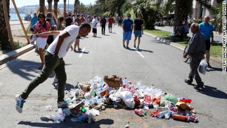 Trash piles up where Nice killer died
