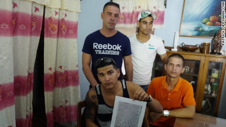 "Walter Marrero, Dadier Hernandez, Liban Concepcion and Sergio Farias were part of a group of 24 Cuban migrants who sent a message in bottle out to sea while they were in U.S. Coast Guard detention. ""This is hell,"" the letter says, alleging mistreatment."