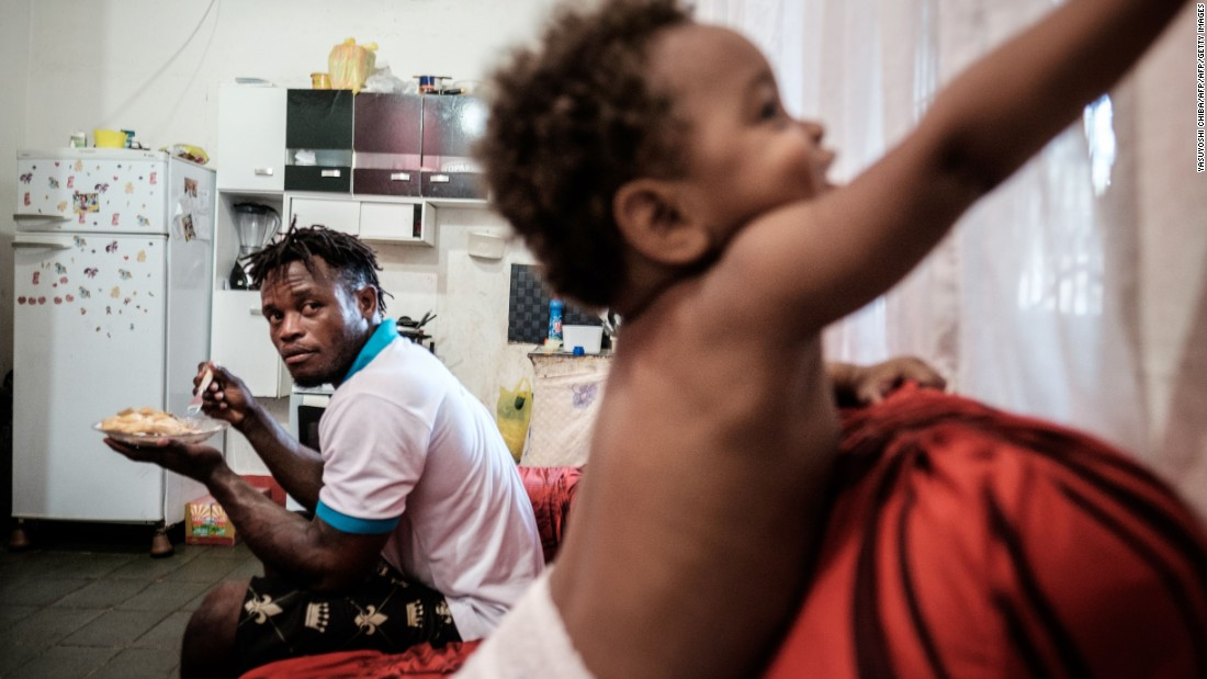 """Misenga, 24, has married a Brazilian and has a young son since being granted asylum. He says Rio is a """"magical place"""" to live."""
