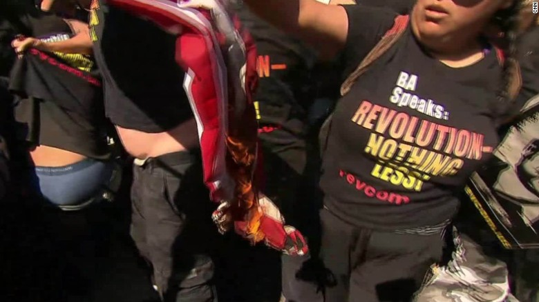 Protesters burn flag outside GOP convention