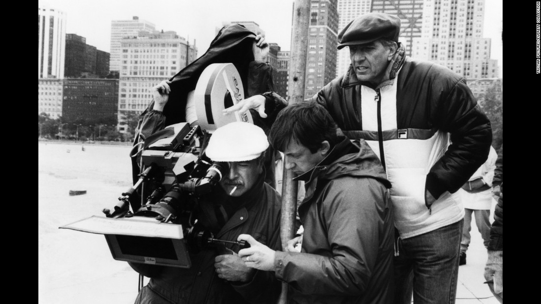 "Marshall, right, watches cinematographer John A. Alonzo film ""Nothing in Common"" in 1986."