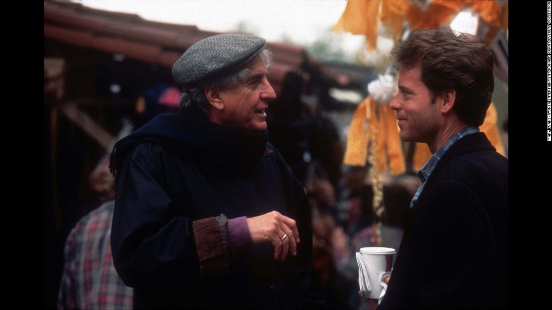 "Marshall talks with actor Greg Kinnear on the set of ""Dear God"" in 1996."