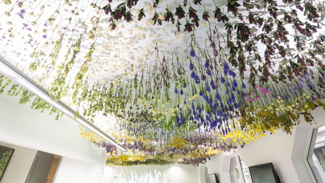 """The City Garden"" (2016) in London uses flowers from the area's public gardens and green spaces and transports it into a sterile, blank interior."