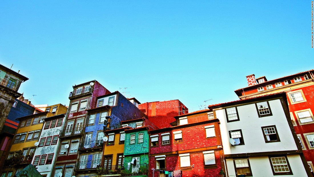 Ribeira Square, flanked by colorful painted houses, is a highlight in Porto's UNESCO-designated historical city center.