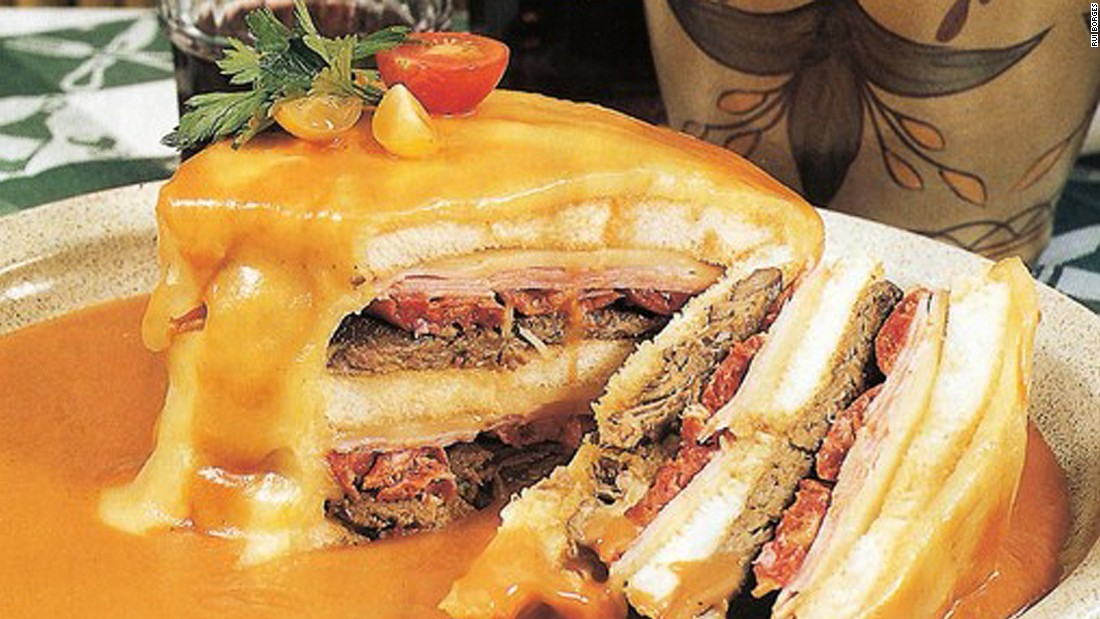 "Porto's favorite snack, francesinha -- or ""little French girl""-- is bread filled with ham, sausages and steak, wrapped in cheese. The combo is then drenched in a spicy sauce."