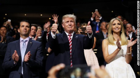 CLEVELAND, OH - JULY 20:  Republican presidential candidate Donald Trump (C) gives two thumbs up as Donald Trump Jr. (L) and Ivanka Trump (R) stand and cheer for Eric Trump as he delivers his speech during the third day of the Republican National Convention on July 20, 2016 at the Quicken Loans Arena in Cleveland, Ohio. Republican presidential candidate Donald Trump received the number of votes needed to secure the party's nomination. An estimated 50,000 people are expected in Cleveland, including hundreds of protesters and members of the media. The four-day Republican National Convention kicked off on July 18.  (Photo by Joe Raedle/Getty Images)