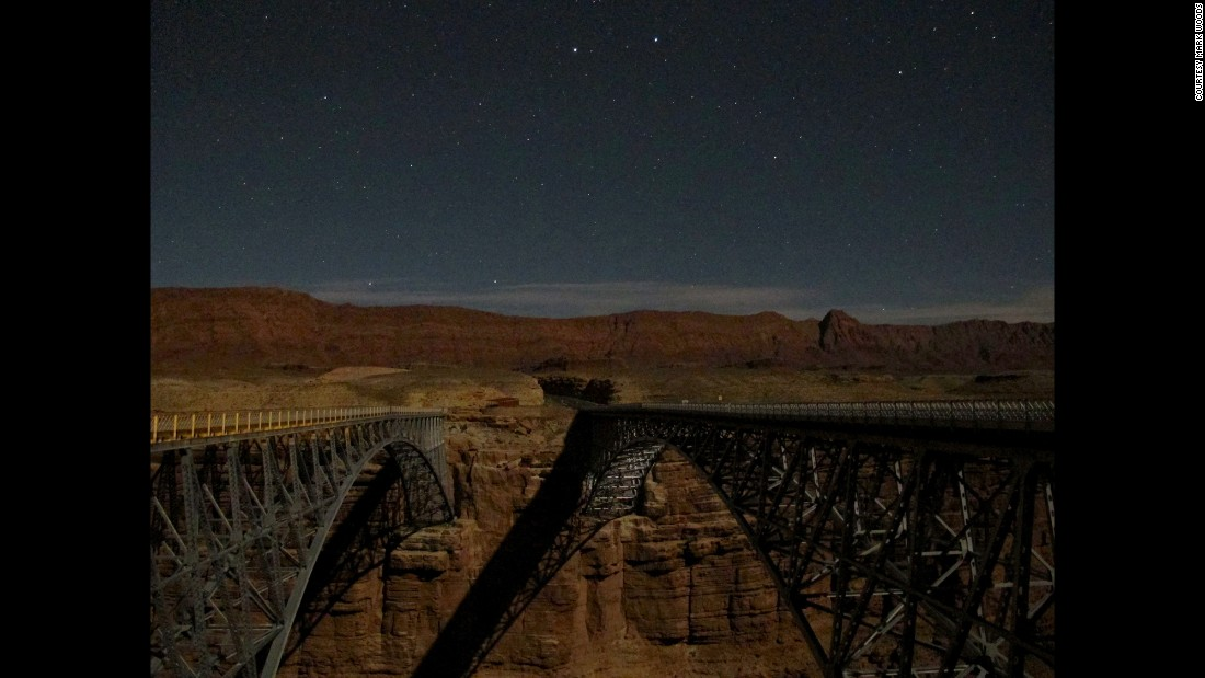 """When I went to northern Arizona for a gathering of river guides, every day I'd walk to the twin bridges that cross Marble Canyon -- the gateway to the Grand Canyon -- and look down at the Colorado River, flowing 467 feet below,"" wrote Woods. ""And every night I'd walk to the same bridges and look up at something perhaps even more stunning, something that brought back a flood of childhood memories: night skies."""