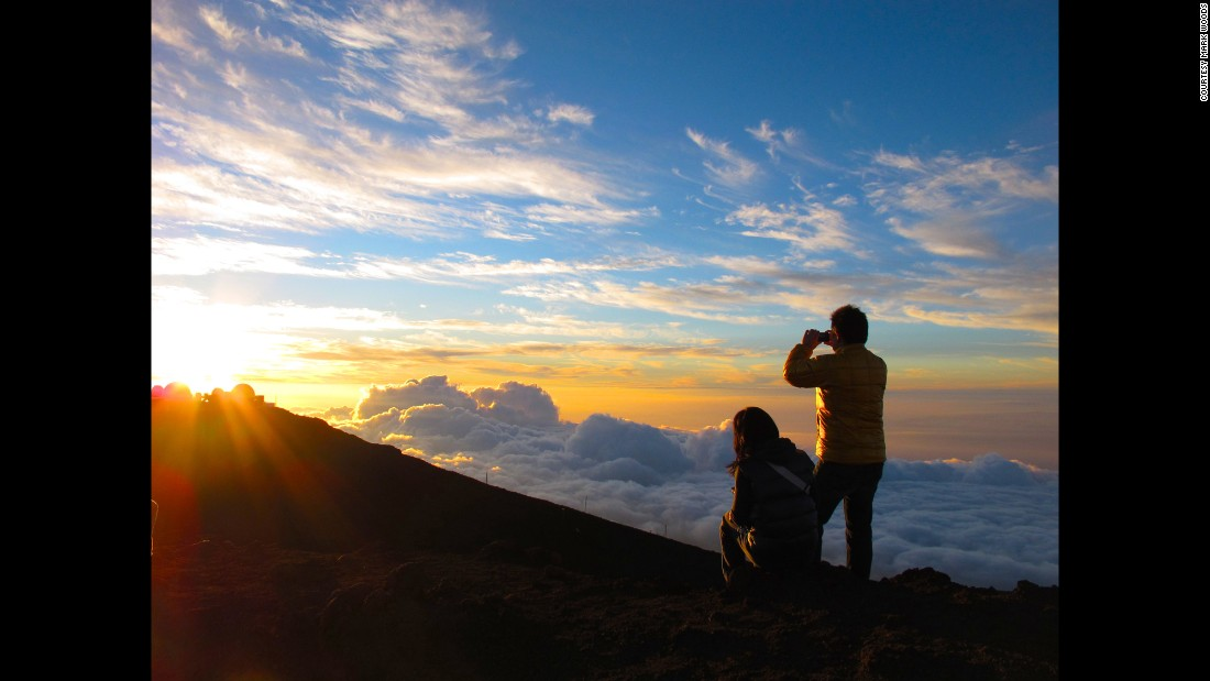 """I was trying to figure out where to end the year when I read that Haleakala means ""House of the Sun"" and the mythology of this mountain involves a son lassoing the sun for his mother -- slowing the sun's movement and extending the day,"" wrote Woods. ""So a year that began with a New Year's Day sunrise atop a mountain in Maine ended with a New Year's Eve sunset atop a volcano in Hawaii.""<br />"