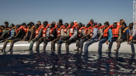 Refugees and migrants wait to be rescued from a dinghy in the Mediterranean Sea last year.