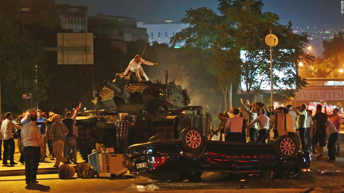 People in Ankara, Turkey, try to stop tanks during the country's failed coup attempt on Saturday, July 16. President Recep Tayyip Erdogan had called on Turks to take to the streets to show their support for the government.