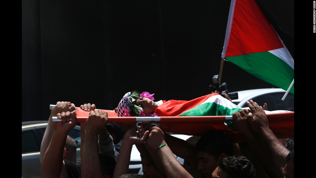 "Mourners carry the body of Muhyi Sedqi al-Tabakhi during his funeral in the West Bank town of Al-Ram on Wednesday, July 20. The Palestinian Ministry of Health said the 12-year-old boy was shot and killed by Israeli forces in the West Bank. Israel police spokeswoman Luba Samri <a href=""http://www.cnn.com/2016/07/19/middleeast/west-bank-palestinian-boy/index.html"" target=""_blank"">disputed the claim</a> and said Israeli forces never opened fire."