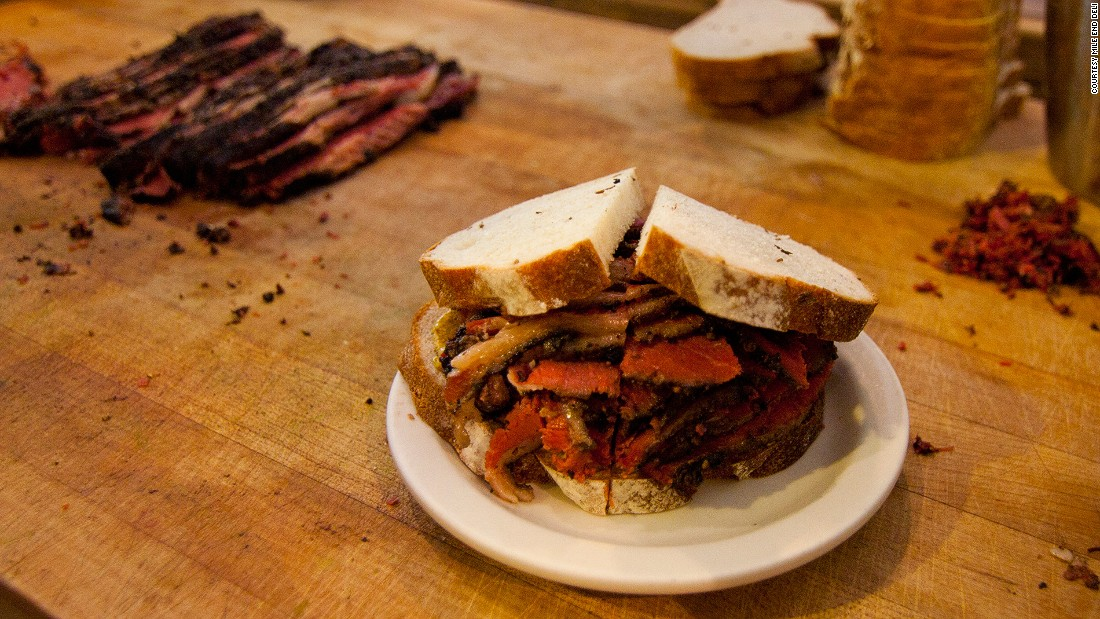 Mile End's uber-popular Smoked Meat Sandwich is packed with dry-cured brisket that's been spiced, smoked and piled high on rye bread (with mustard, natch).