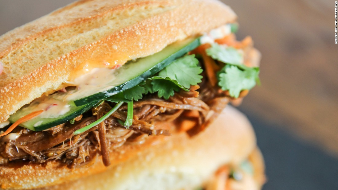 Num Pang Sandwich Shop, a Cambodian banh mi-style sandwich shop, serves an addictive pulled Duroc pork with spiced honey, accompanied by cucumber, pickled carrots, cilantro and chili mayo.