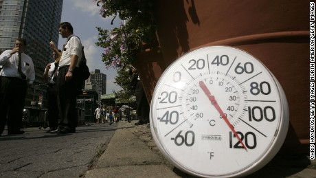 NEW YORK - AUGUST 02:  A thermometer in the sun on the sidewalk indicates a temperature of 120 degrees Fahrenheit as people eat ice cream on the Upper West Side August 2, 2006 in New York City. Forecasters have called for high temperatures of 100 degrees in the city with the heat wave continuing through tomorrow.  (Photo by Chris Hondros/Getty Images)