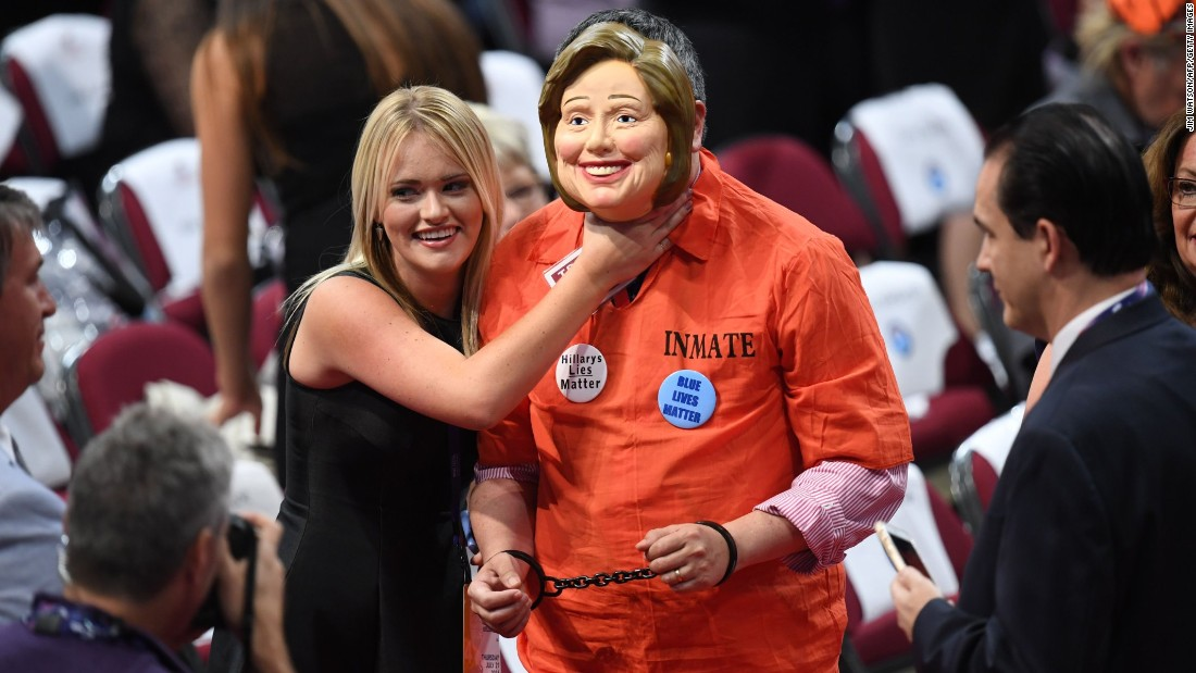 A delegate dressed as Hillary Clinton is accosted by another delegate on Thursday.