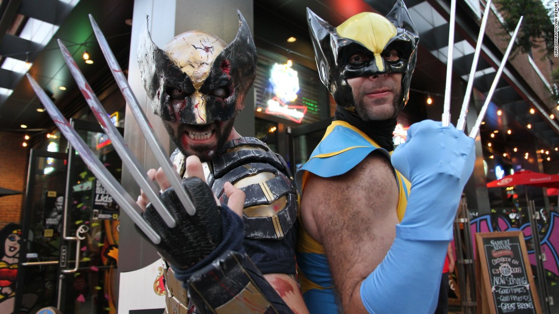 Two fans who met at the convention show off their homemade Wolverine costumes.