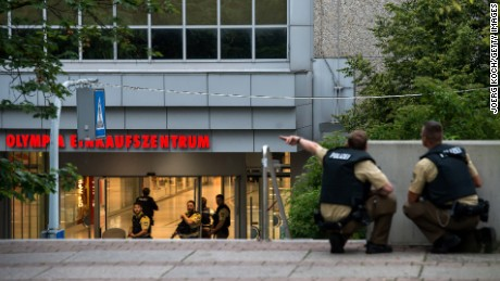 Police officers respond to a shooting at the Olympia Einkaufzentrum (OEZ) at July 22, 2016 in Munich, Germany.  According to reports, several people have been killed and an unknown number injured in a shooting at a shopping centre in the north-western Moosach district in Munich. Police are hunting the attacker or attackers who are thought to be still at large.