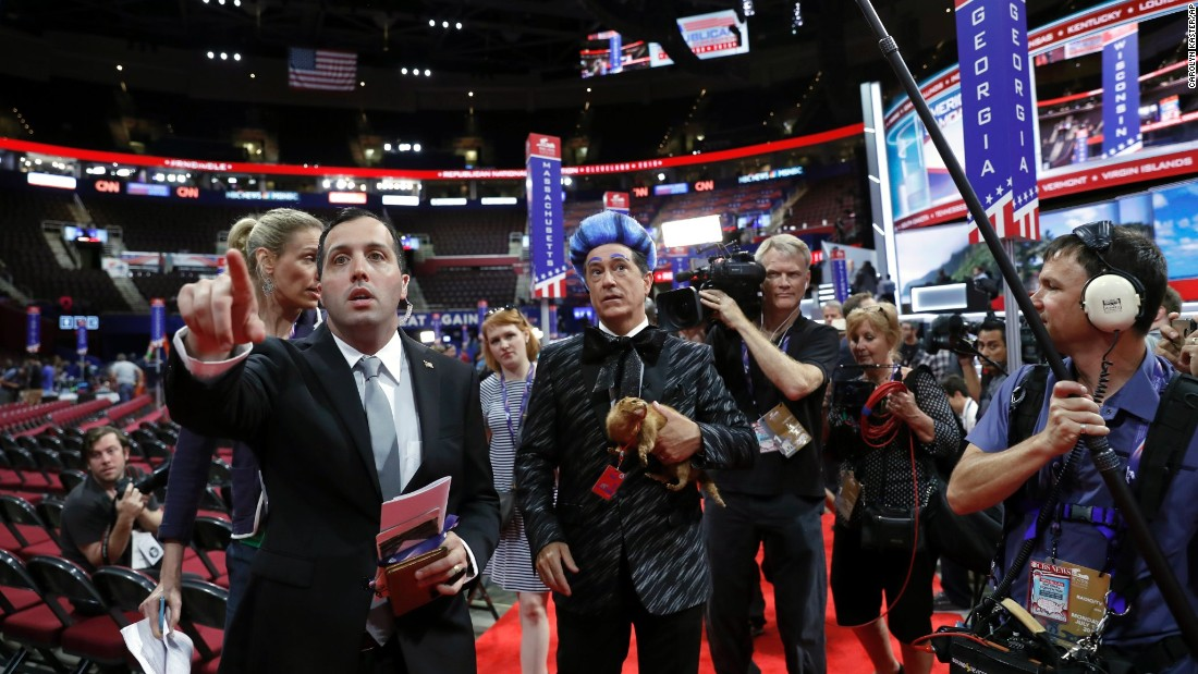 Talk-show host Stephen Colbert, in the blue hair, tapes a segment at the site of the Republican National Convention on Sunday, July 17.
