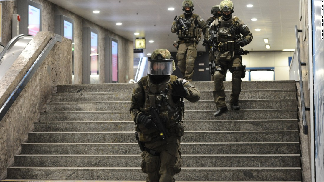 "Police secure an underground transit station after a deadly shooting in Munich, Germany, on Friday, July 22. At least eight people were killed at a nearby shopping mall in what police officials said ""looks like a terror attack."" Police are still looking for the gunmen."