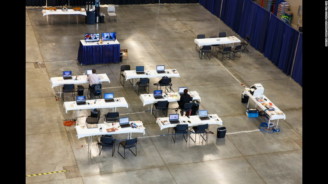 Members of the media work at a nearby convention center.