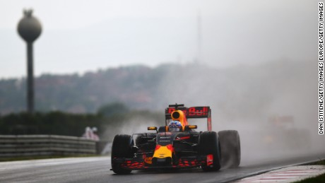 Daniel Ricciardo of Red Bull drives through the rain during qualifying for the Hungarian Grand Prix.