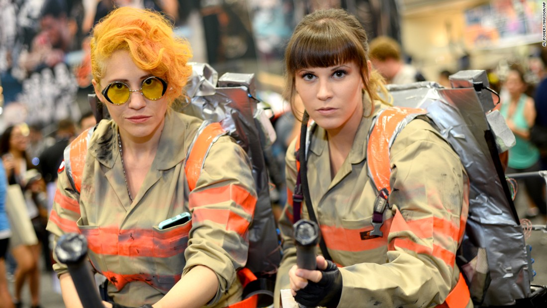 "Sara Maldonadao of Denver, left, and Alison Sumo of Placentia, California, dress as characters from the new version of ""Ghostbusters."""