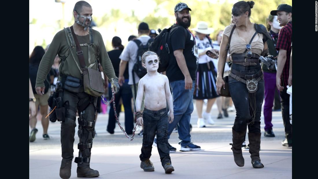 "A family of ""Mad Max"" fans: David LeBeau, dressed as Mad Max, left; Liam LeBeau, as Nux; and Riana LeBeau, as Furiosa."